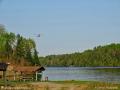 Float plane flying over the Tobique River