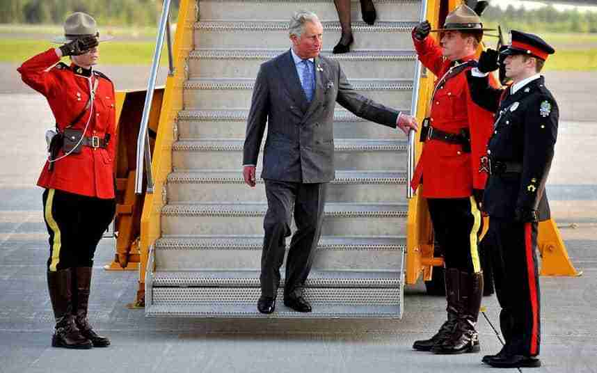 Mounties salute as the Prince of Wales arrives at Fredericton International Airport to start a four.