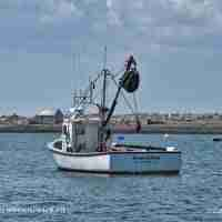 Fishing boat anchored at Dark Harbour Pond Grand Manan NB