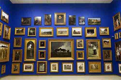 Salon Hanging, over 100 works of art, many from the Owens Art Galleries original collection first acquired in the 1880s.